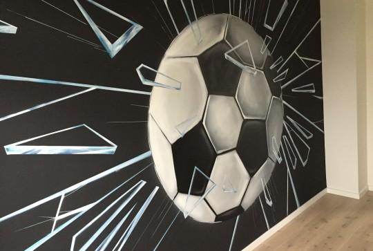 Voetbal door glas 4